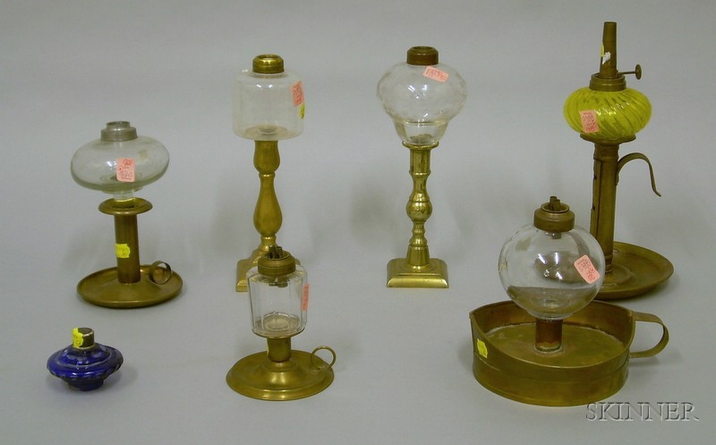 Seven Glass Peg Lamps on Brass Candlestick Bases