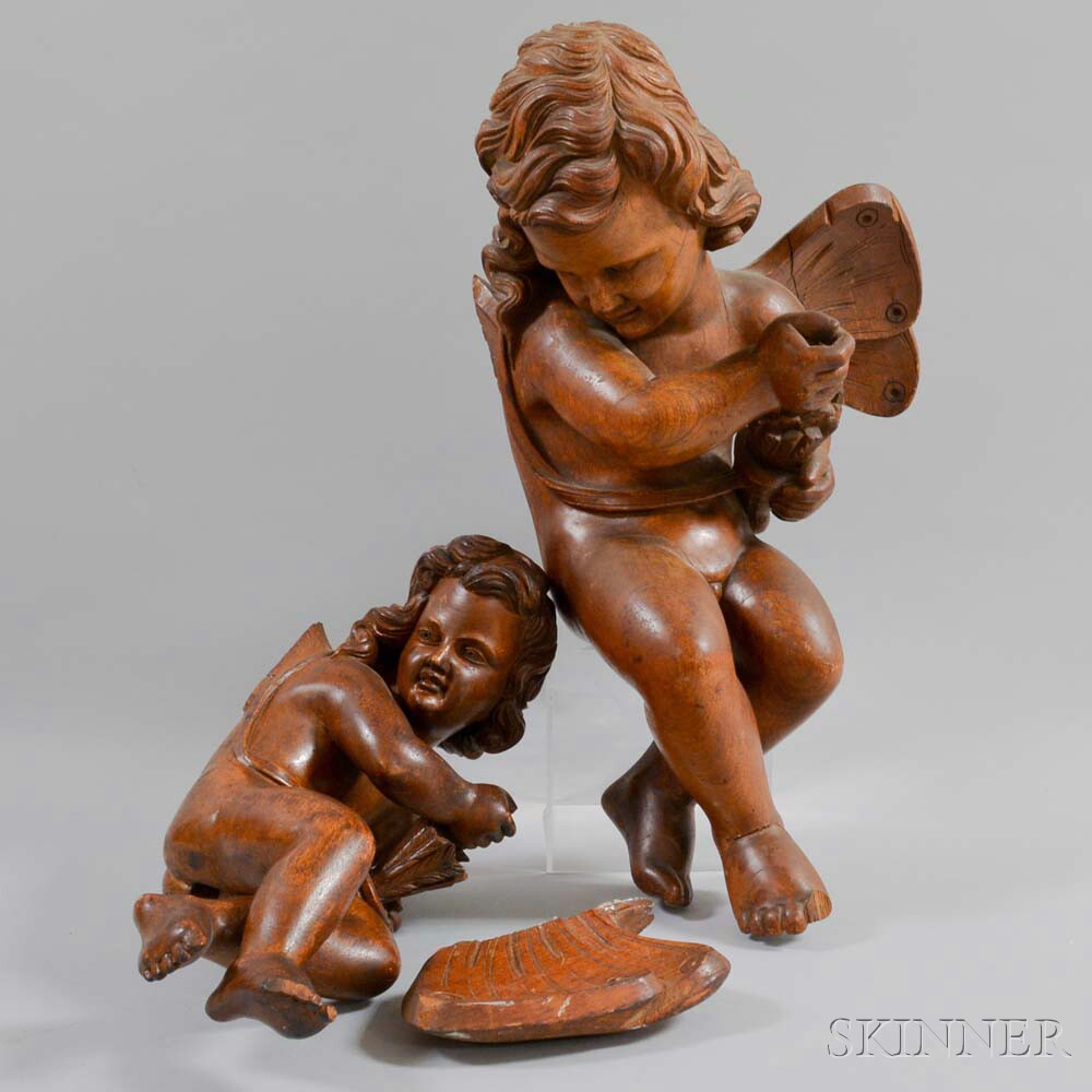 Two Continental Carved Walnut Putti
