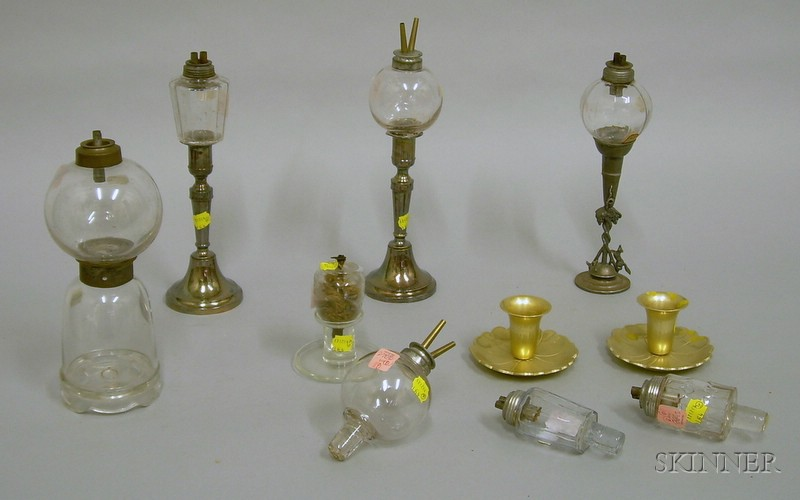 Eight Colorless Glass Peg Lamps with Seven Glass and Metal Bases.