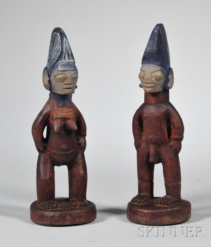 Two Pairs of Carved Wooden Ibeji Dolls