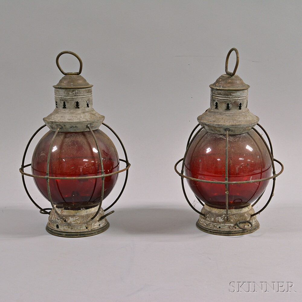 Two Tin and Red Glass Lanterns