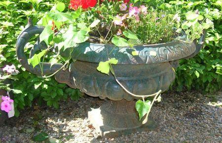 Pair of Dark Green Painted Cast Iron Two-handled Garden Urns