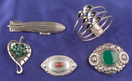 Three Silver Brooches and Hinged Bangle