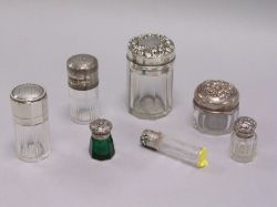 Group of Seven Sterling Silver Mounted Glass Dresser Jars and Vials.