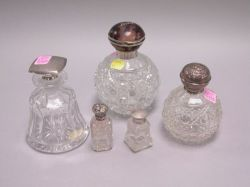 Five Sterling Silver Mounted Colorless Cut Glass Dresser Jars and Vials.