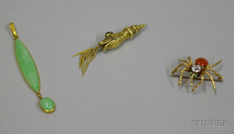 Gold and Jade Pendant, a Costume Spider Brooch, and a Fish-form Pendant.