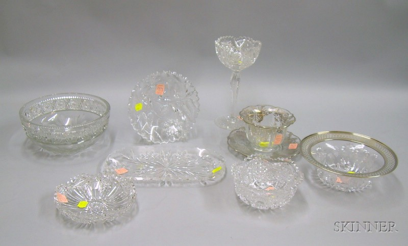 Nine Pieces of Colorless Cut, Silver-mounted and Overlaid Glass Table Items