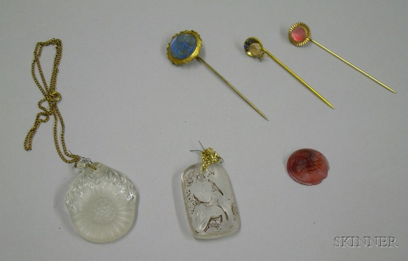 Two Molded Glass Pendants, Three Molded Glass Face Stickpins, and a Loose Glass Face Plaque.