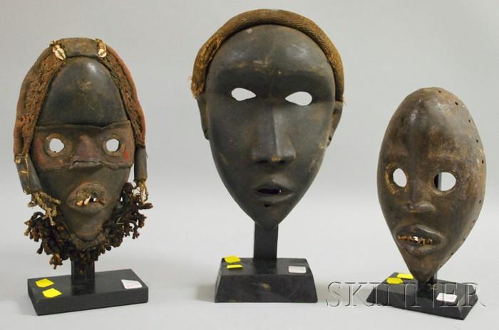 Three Carved Wooden Dan Masks