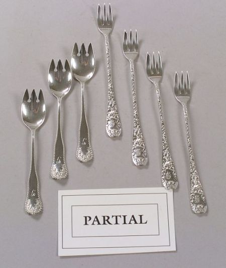 Eighteen Sterling Silver Seafood Forks