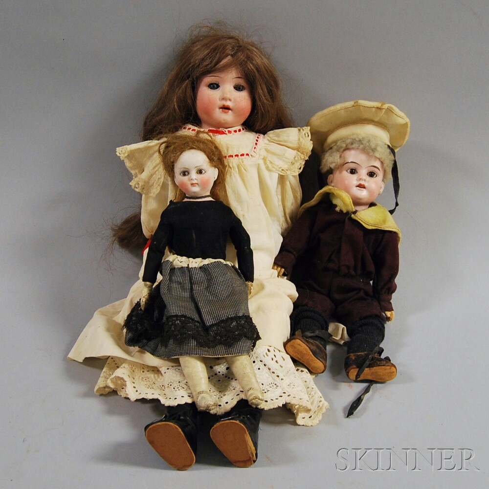 Three Small Dolls