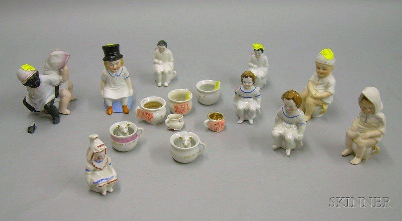Collection of Nine Small Bisque and Porcelain Children on Chamber Pots and Seven Miniature Chamber Pots.