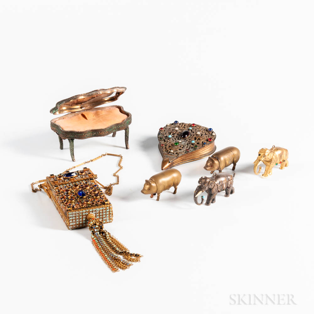 Seven Figural Compacts