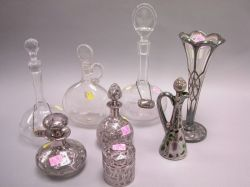 Five Sterling Silver Mounted Dresser Articles, a Ewer, Vase and Three Clear Decanters.