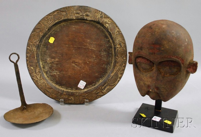 Yorubi Divination Tray, Iron Hand-forged Lamp, and an Ancestor Mask.