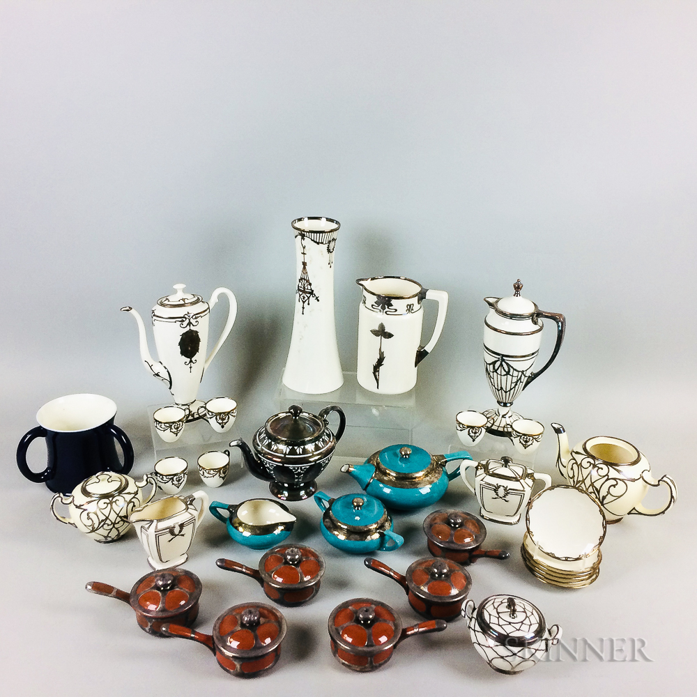 Thirty-two Silver Overlay Ceramic Tableware Items.     Estimate $200-400