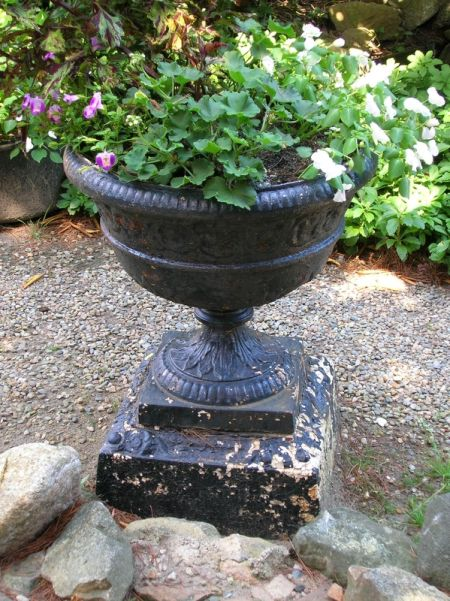 Two Black Painted Cast Iron Garden Urns
