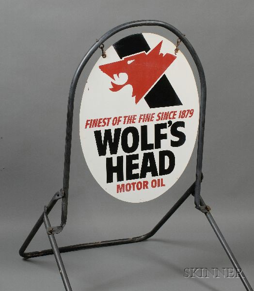 Wolfs Head Motor Oil Sign on Stand.
