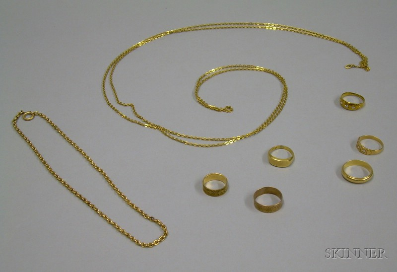 Five Gold Bands, a 10kt Gold Signet Ring, and Two Gold Chains.