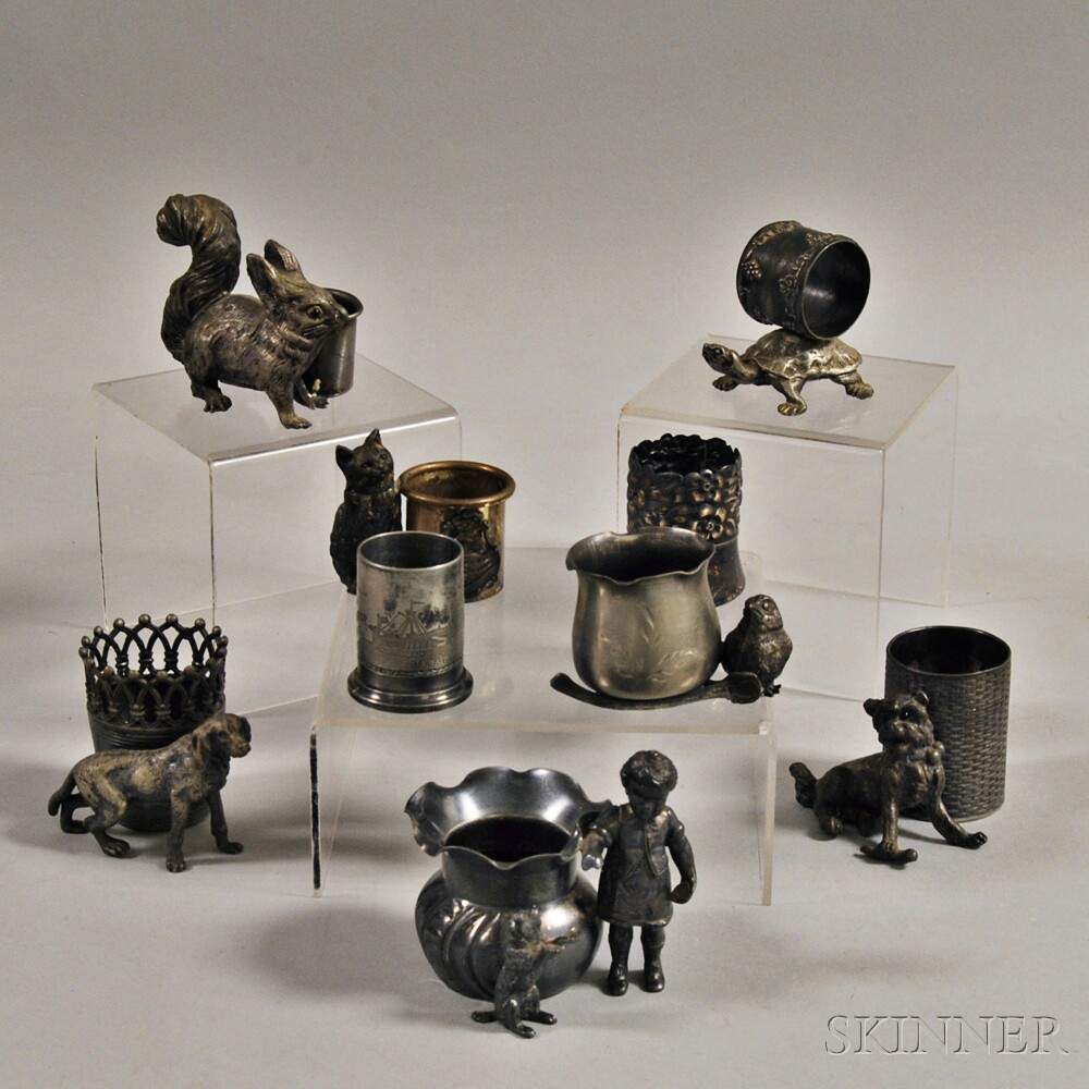 Nine Silver-plated Figural Toothpick Holders and a Napkin Ring