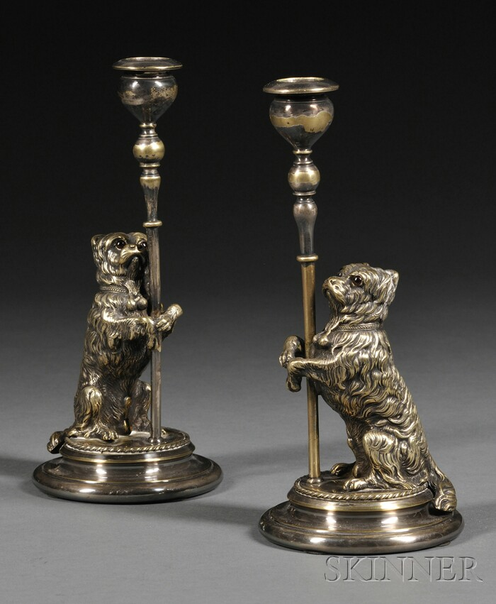 Pair of Terrier-form Silvered Brass Candlesticks