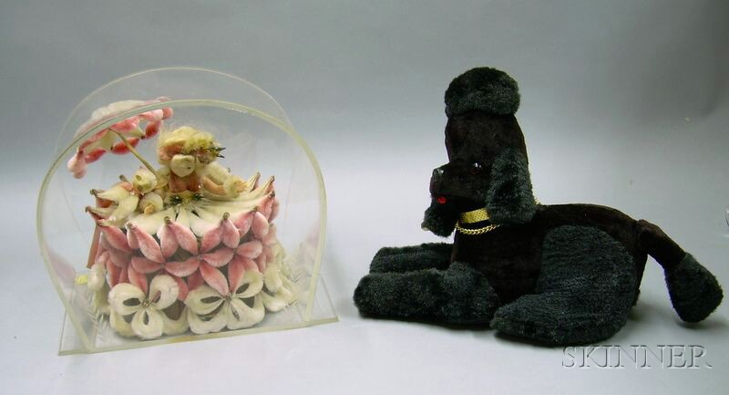 Japanese Poodle Mascot Transistor Radio and a Lucite-cased Pipe Cleaner Doll.