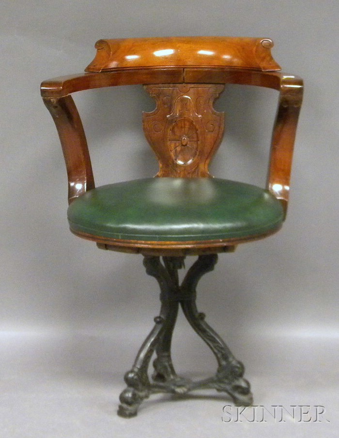 Victorian Upholstered Carved Walnut and Cast Iron Swivel Chair.