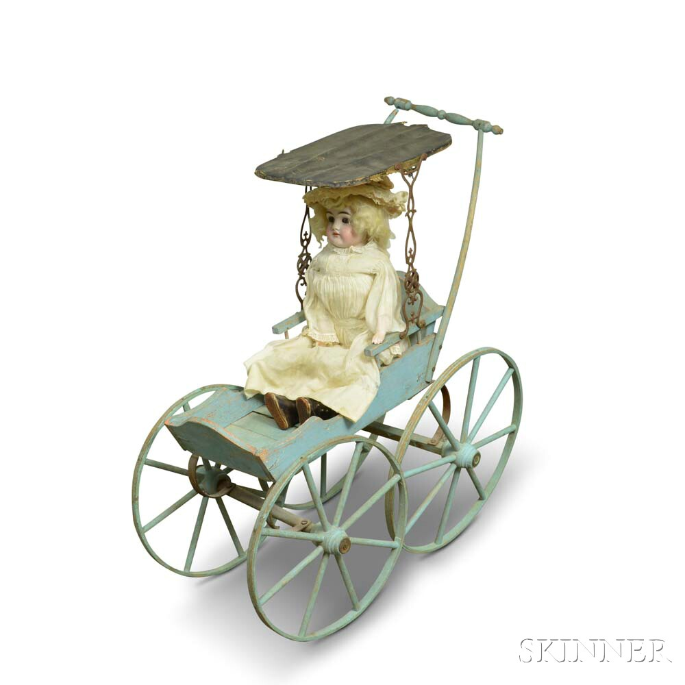 Painted Doll Carriage and a Bisque Shoulder Head Doll.     Estimate $100-150