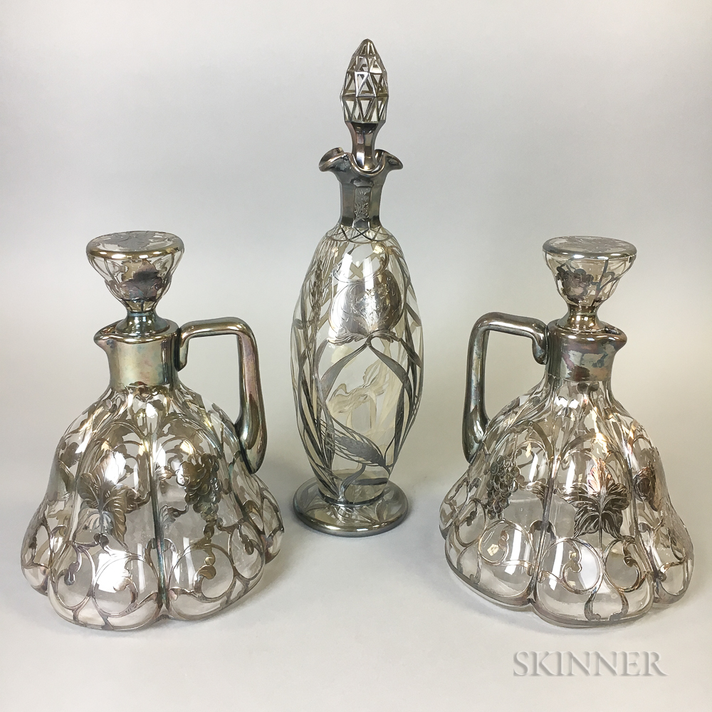 Three Silver Overlay Colorless Glass Decanters