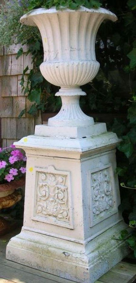 Pair of White Painted Cast Iron Garden Urns on Pedestals