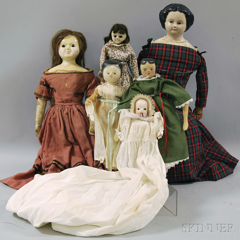 Six Waxed Composition, Wood, and Papier-mache Dolls