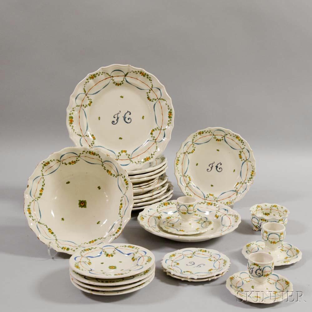 Twenty-four Pieces of Polychrome Faience Pottery Tableware.     Estimate $150-250