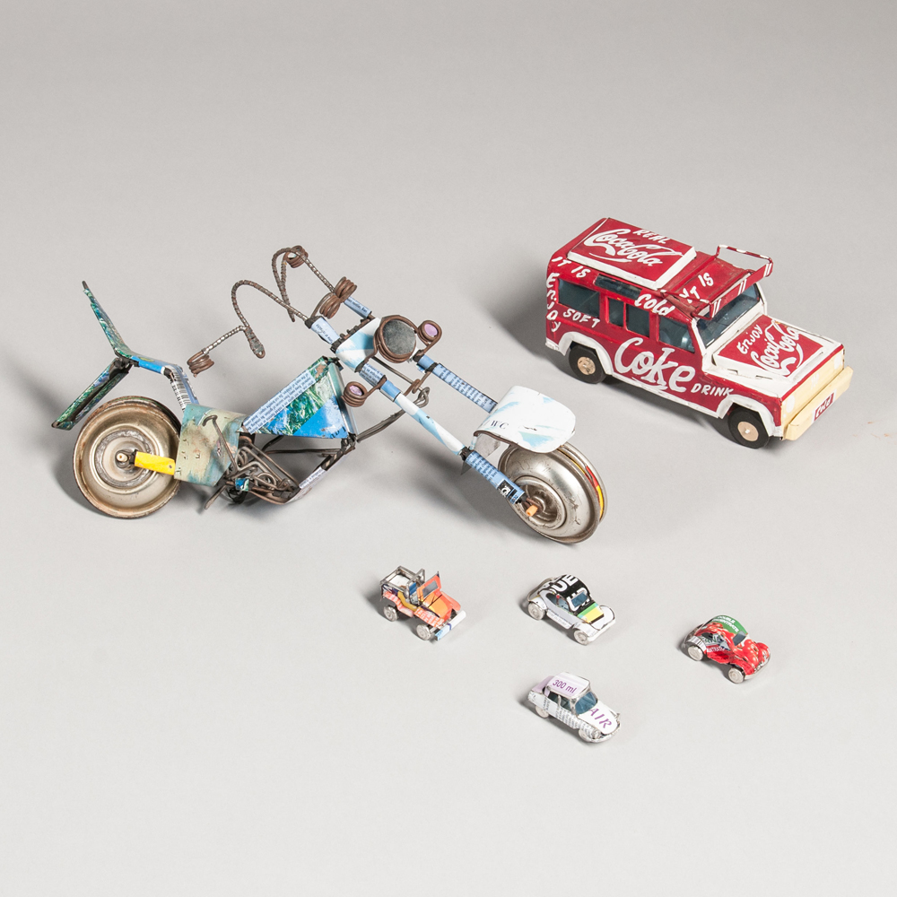 Group of Contemporary African Recycled Tin, Wire, and Plastic Toys.