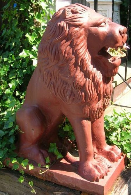 Pair of Red Painted Cast Iron Seated Lion Ornaments
