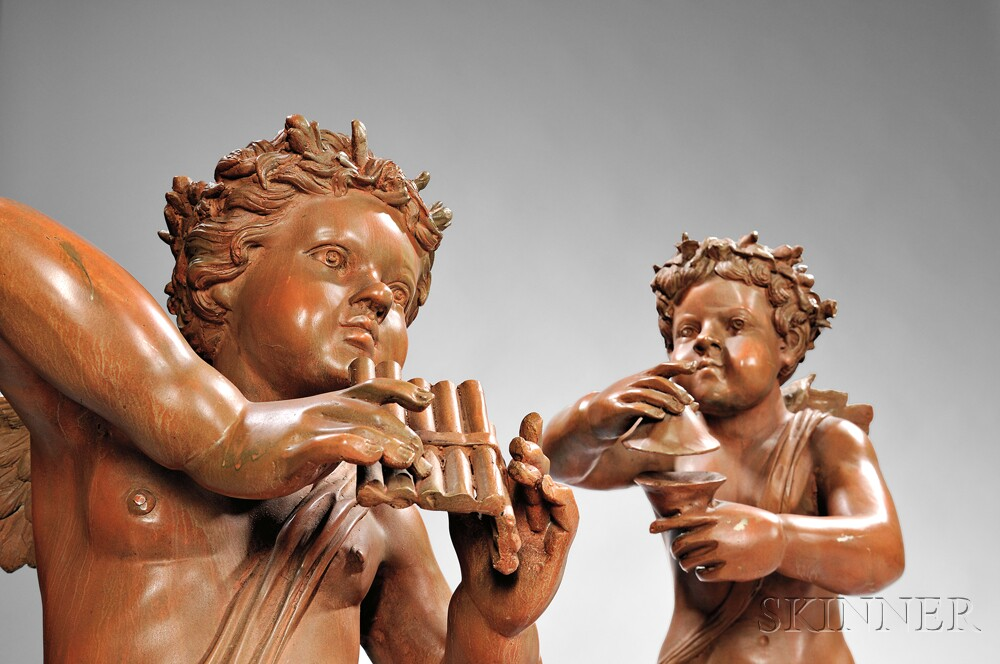 Set of Four Brown-painted Cast Metal Figures of Cupid Musicians