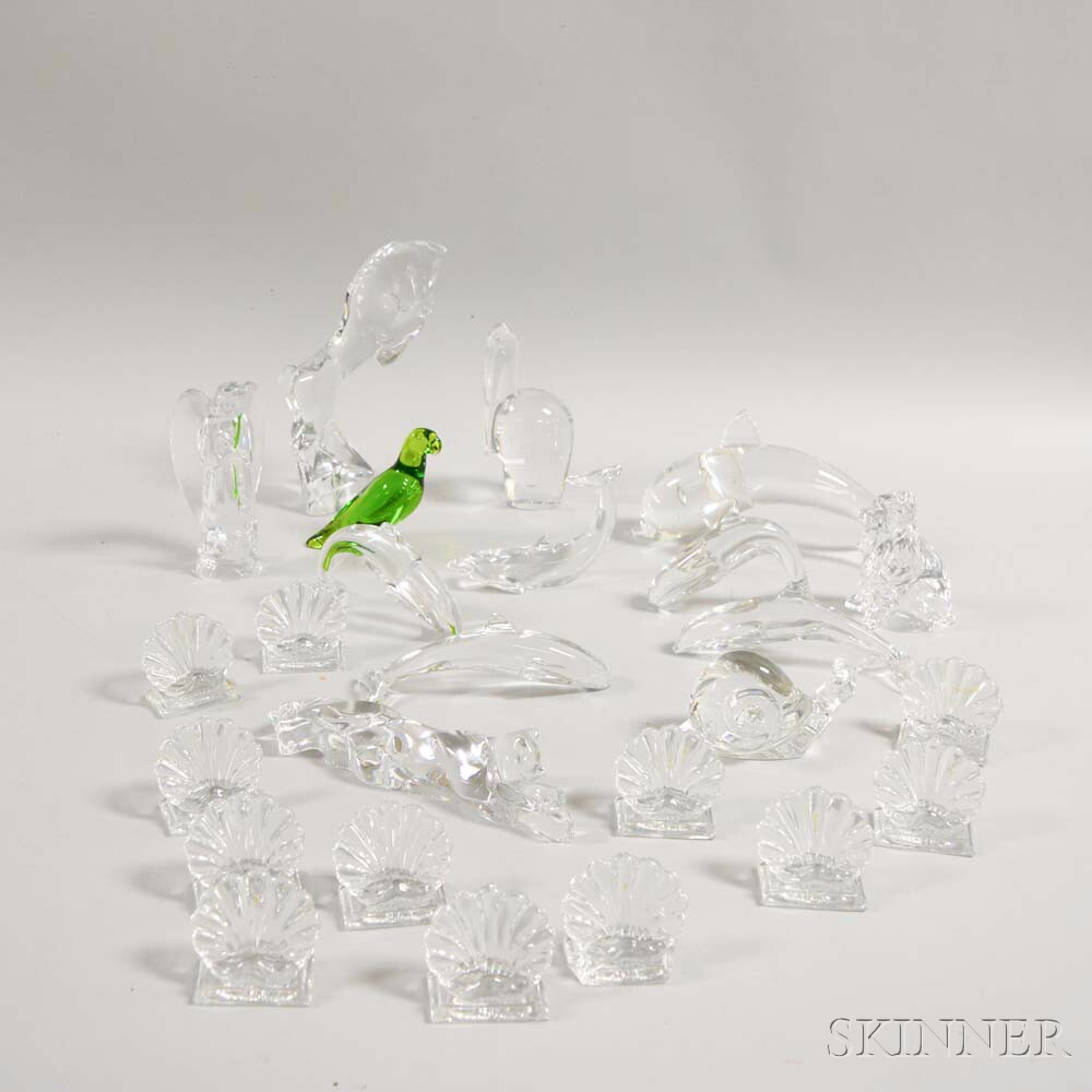 Twenty-five Baccarat Colorless Glass Animals and Place Card Holders.     Estimate $400-600