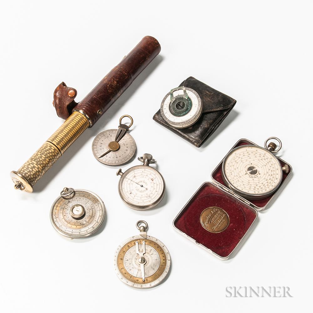 Seven Long Scale Pocket Calculators