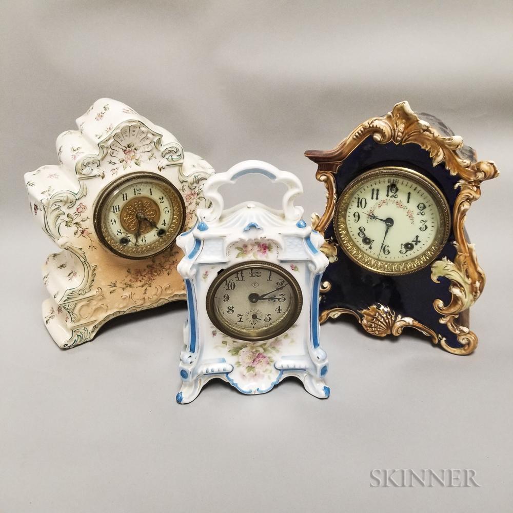 Three Small China Case Clocks