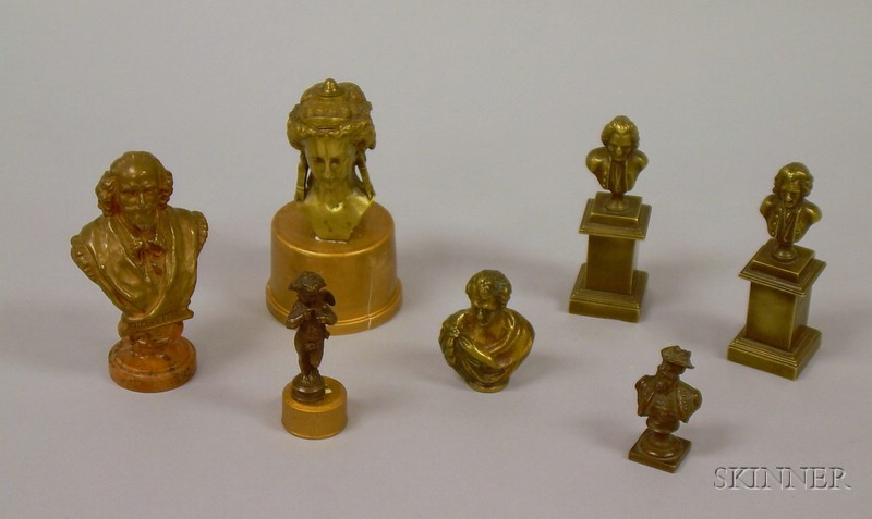 Six Small Classical and Historical Bronze Busts and a Cherub Figural Seal