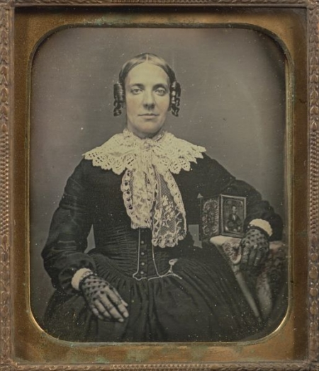 Daguerreotype Portrait of a Lady with a Photograph