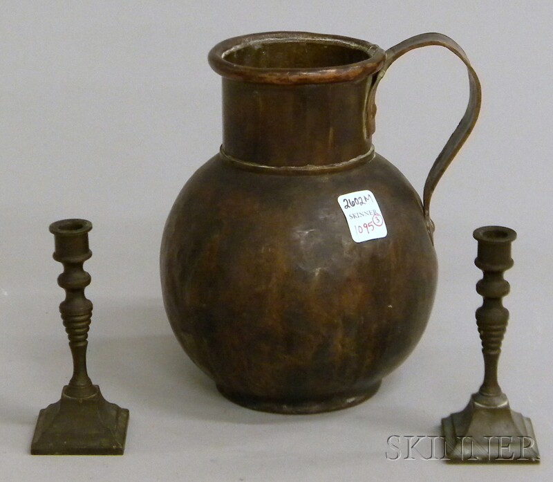 Pair of Bronze Tapersticks and Brass and Copper Jug
