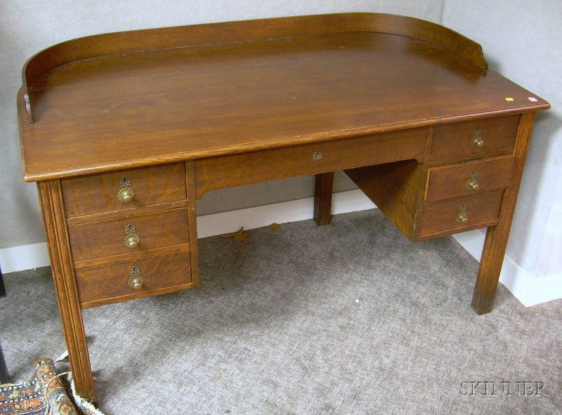 Irving & Casson/A.H. Davenport Attributed Carved Oak and Oak Veneer D-shaped Flat-top Desk.