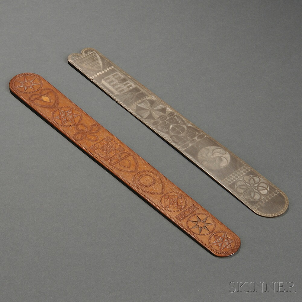 Two Carved Busks