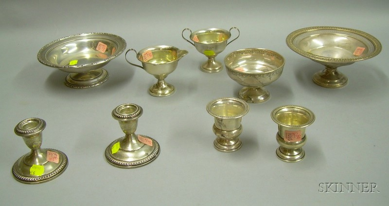 Nine Weighted Sterling Silver Table Items