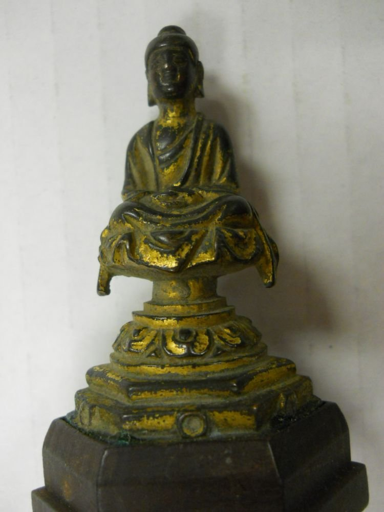Fifteen Buddhist Gilt-bronze and Bronze Miniature Items