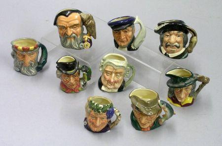 Nine Miniature Royal Doulton Character Jugs