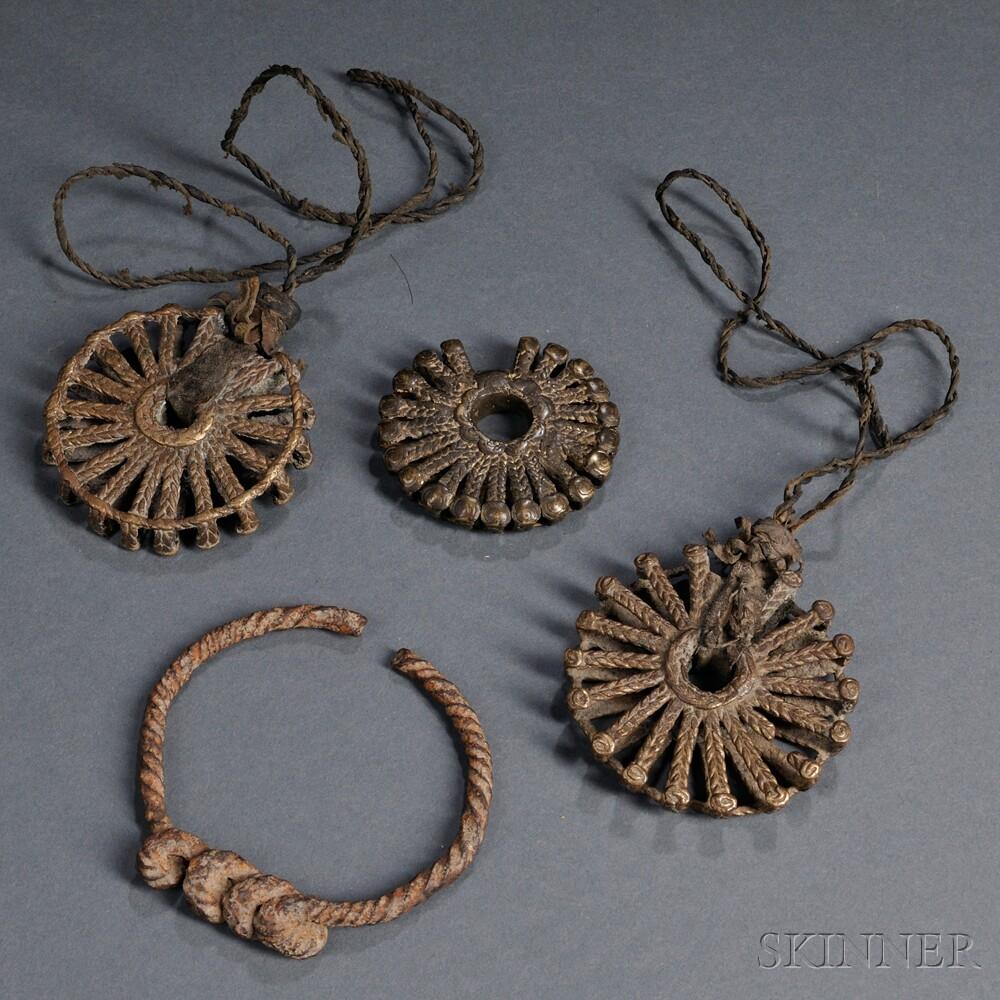 Three Dogon Brass Sunburst Pendants and a Forged Iron Bracelet