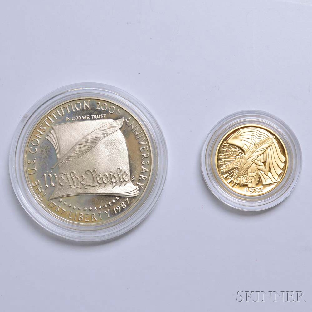 Cased Gold $5 and Silver Dollar Proof Constitution Coins.     Estimate $200-400