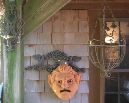 Group of Assorted Decorative Metal Wall Hooks, Sconces, a Hanging Basket, and Two Terra-cotta Garden Wall Masks.