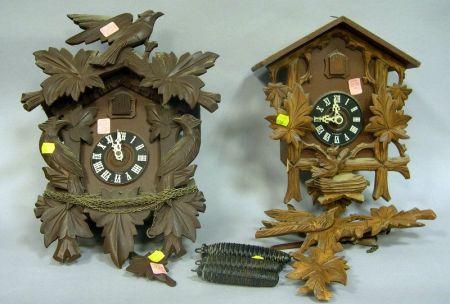 Two Carved Wood Cuckoo Clocks